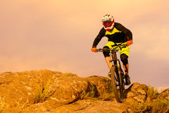 Professional Cyclist Riding the Bike on the Top of the Rock. Extreme Sport Concept. Space for Text. Royalty Free Stock Image