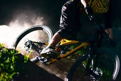 Professional Cyclist Riding the Mountain Bike on the Forest Trail. Extreme Sport and Enduro Cycling Concept. stock image