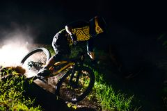 Professional Cyclist Riding the Mountain Bike on the Forest Trail. Extreme Sport and Enduro Cycling Concept. stock photo