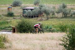 Professional cyclist riding outdoors royalty free stock photography