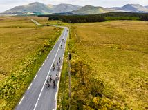 Professional cyclists competing in Connemara region in Ireland. Scenic Irish countryside landscape with mountains on the horizon,. Professional cyclists stock photography