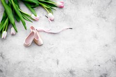 Professional dance shoes. Ballet concept. Pointes on grey background top view copy space. Professional dance shoes. Ballet concept. Pointes on grey background Royalty Free Stock Images