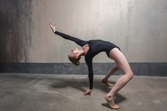 Professional dancer doing bridge posture. Studio shot royalty free stock images