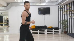 The professional dancer rehearses. He is in the hall for rehearsals. Rehearses the dance contemporary. contemporary. it. Is constantly improved and unites in stock video footage