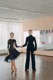 Professional dancers dancing in ballroom. Latin. Royalty Free Stock Image