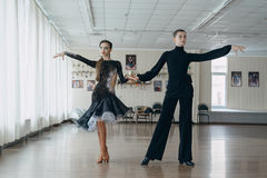 Professional dancers dancing in ballroom. Latin. Royalty Free Stock Photo