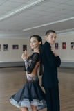 Professional dancers dancing in ballroom. Latin. Stock Photography