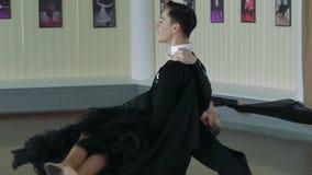 Professional dancers dancing in ballroom, slow motion stock video