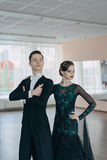 Professional dancers dancing in ballroom Royalty Free Stock Photos