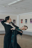 Professional dancers dancing in ballroom Stock Photos