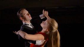 Professional dancers dancing in the studio on dark background. Professional dancers dancing in the studio stock video