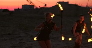 Professional dancers women make a fire show and pyrotechnic performance at the festival with burning sparkling torches. stock footage