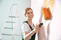 Professional decorator painting wall. Home repair service royalty free stock photography