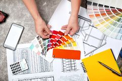 Professional decorator working at table top view. Professional decorator working at table, top view stock images