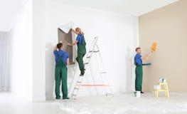Professional decorators working. Home repair service. Professional decorators working indoors. Home repair service royalty free stock photos