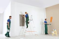 Professional decorators working. Home repair service. Professional decorators working indoors. Home repair service royalty free stock images