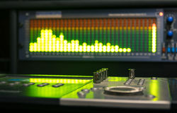 Professional deejay equipment with spectrum analyzer. Professional deejay equipment with music mixing controller and sound equalizer Royalty Free Stock Photo