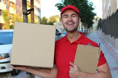 Professional delivery man smiling at work stock photography