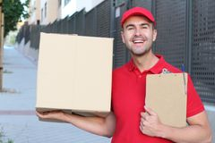 Professional delivery man smiling at work stock photo