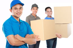 Professional delivery services. Portrait of professional delivery services with package stock image