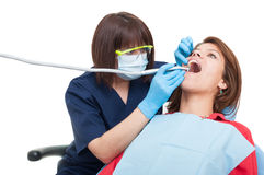 Professional dental drilling procedure on upper teeth Royalty Free Stock Photos