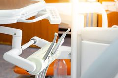 Instruments on dental chair in dentist office. Professional dental instruments on dental chair in dentist office or clinic stock image