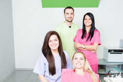 Professional dental team and smiling patient. As stomatology concept royalty free stock images