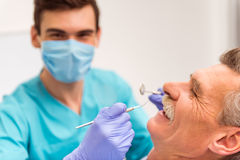 Professional dentist office. Close-up. Elderly men on reviewing the dentist royalty free stock photos