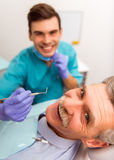 Professional dentist office. Close-up. Elderly men on reviewing the dentist royalty free stock photography