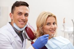 Professional dentist working at his dental clinic royalty free stock images