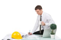 Professional designer sitting on table and drawing. Royalty Free Stock Photography