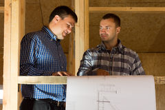 Professional Designers Talk About Building Plans. Middle Age Male Professional Designers Talk About the Building Designs at the Site Stock Images