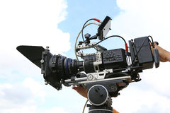 Professional digital camera. For filming movies and television on the sky backgroun royalty free stock photos
