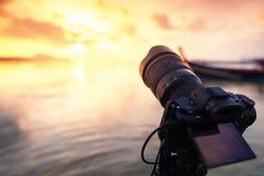Professional digital camera focus sunrise view at beach Stock Photo