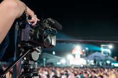 Professional digital camera recording video in music concert festival.  stock photos