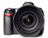 Professional digital photo camera. With huge standard lens isolated on white royalty free stock image