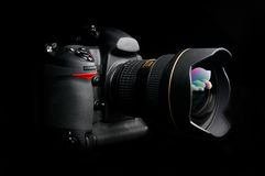 Professional digital photo camera. With zoom lens on black background Stock Photo