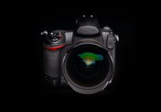 Professional digital photo camera. With zoom lens on black background Royalty Free Stock Photography