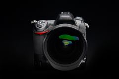 Professional digital photo camera. With zoom lens on black background royalty free stock photos