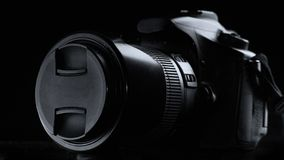 Professional digital photo camera against black background. Close up royalty free stock photography
