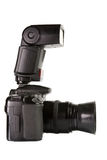 Professional digital photo camera side view. Professional digital photo camera with external flash side view royalty free stock photos