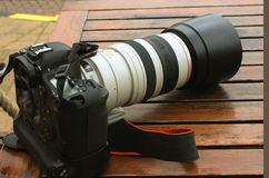 Professional digital photo camera with tele lenses Royalty Free Stock Image