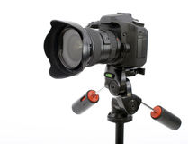 Professional digital photo camera on a tripod Royalty Free Stock Images