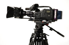 Professional digital video camera. Professional digital video camera on a white background Stock Images