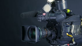 Professional digital video camera, cacoder isolated on black background in tv srudio. stock video