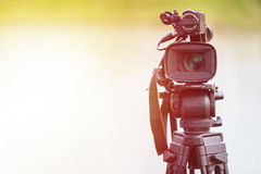Professional digital video camera. Outdoor setup and working Stock Photography