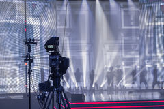 Professional digital video camera, tv camera in a concert hall royalty free stock photos
