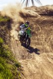 Professional dirt bike rider. Extreme Motocross MX Rider riding on dirt track stock photography