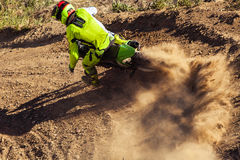 Professional dirt bike rider. Motocross rider creates a large cloud of dust and debris stock photos