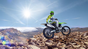 Professional dirt bike rider on top of vulcan Royalty Free Stock Photo
